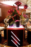 Uniquely DC's elegant Black and Gold themed gala dinner event - LED lit pedestals with custom modern floral arrangements designed on location