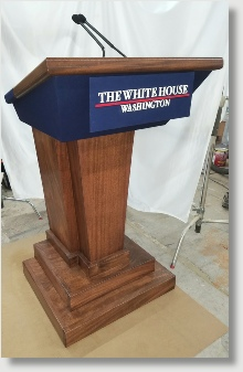 """The Whiter House Press Briefing Room """"Replica"""" lectern. -    Our craftsment hand tool raw lumber into stunning presentation pieces.  Please inquire to Uniquely DC about our custom fabrication services."""