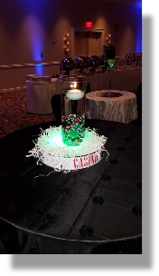 Uniquely DC Casino Events with memorable lighted Casino Centerpieces and table linens for your next very special event.