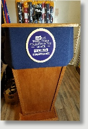 Uniquely DC customized Wood and metal rental  lecterns / Podiums available for business meetings and special events in Washington DC.  The blue fin is removable and easily replaced with your company or event logo.